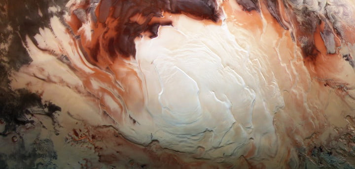 The bright white region of this image shows the icy cap that covers Mars' south pole, composed of frozen water and frozen carbon dioxide. ESA's Mars Express imaged this area of Mars on Dec. 17, 2012, in infrared, green and blue light, using its High Resolution Stereo Camera.