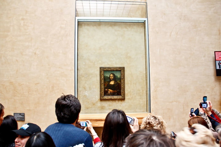 taking pictures improves visual memory 13413625  visitors take photo of the famous painting mona lisa