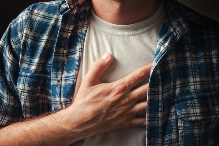 ai algorithm heart attack 13876589  young adult man suffering from severe chest pain