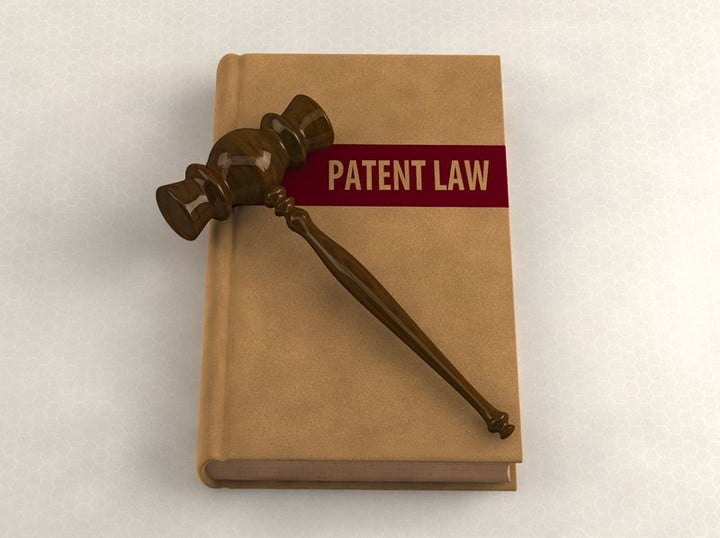 canon patents 2016 14854497  gavel on a patent law book conceptual illustration