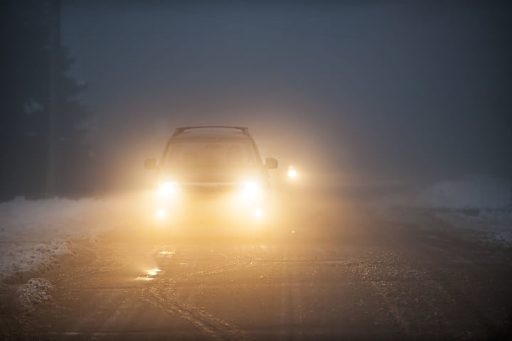 us drivers uncomfortable driving nighttime 19014564  bright headlights of a car on foggy winter road