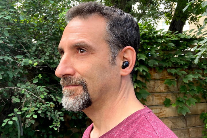 Man wearing 1More ColorBuds 2 true wireless earbuds.