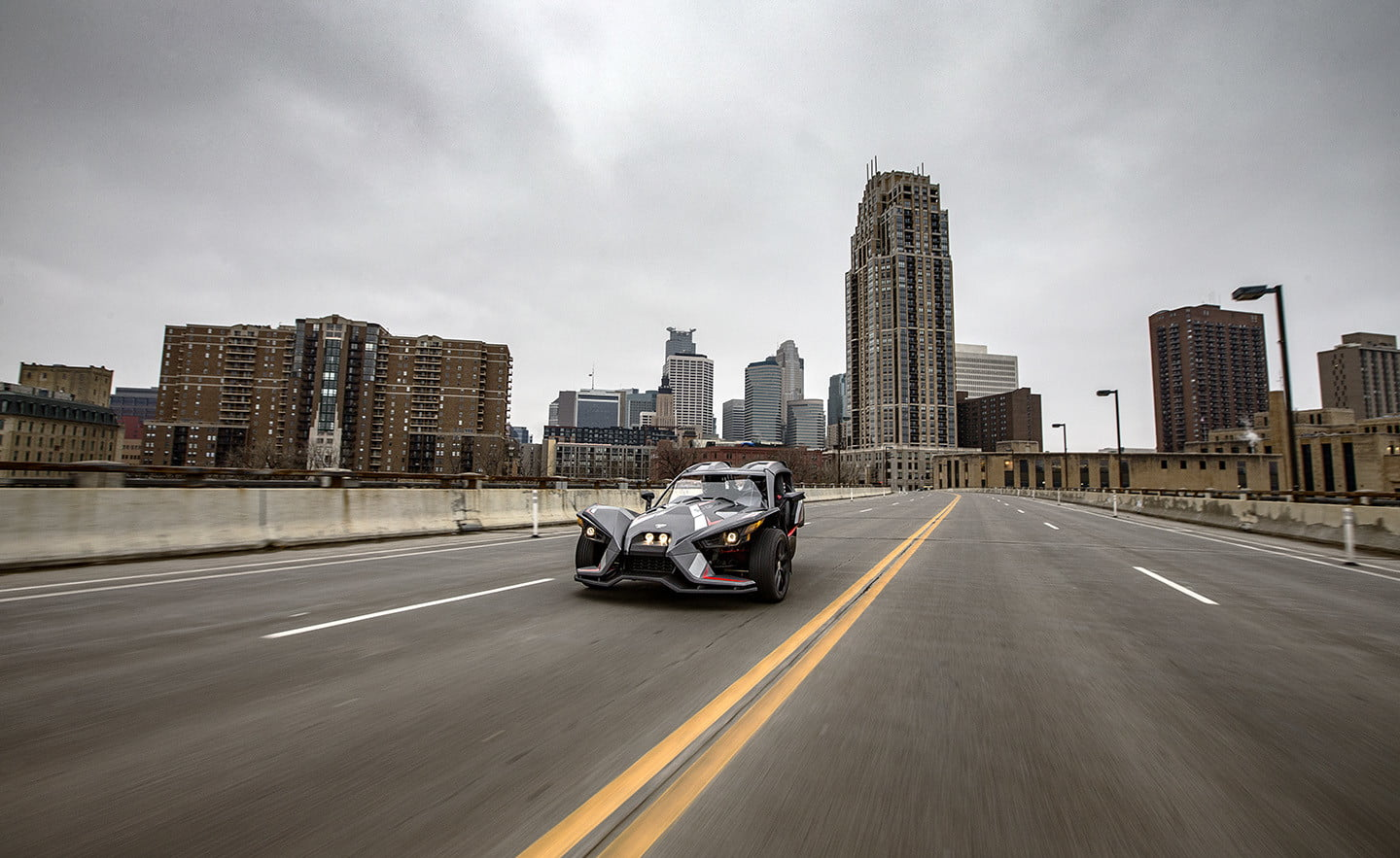 2018 Slingshot Grand Touring LE hero shot driving down the road side
