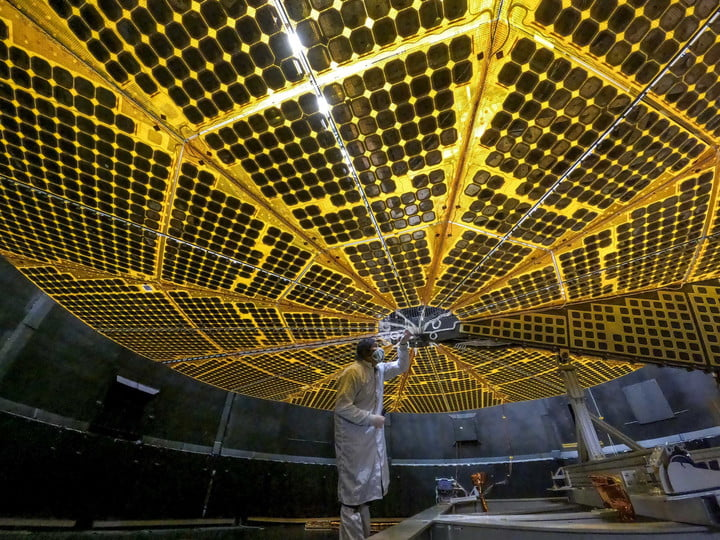 At 24 feet (7.3 meters) across each, Lucy's two solar panels underwent initial deployment tests in January 2021. In this photo, a technician at Lockheed Martin Space in Denver, Colorado, inspects one of Lucy's arrays during its first deployment. These massive solar arrays will power the Lucy spacecraft throughout its entire 4-billion-mile, 12-year journey through space as it heads out to explore Jupiter's elusive Trojan asteroids