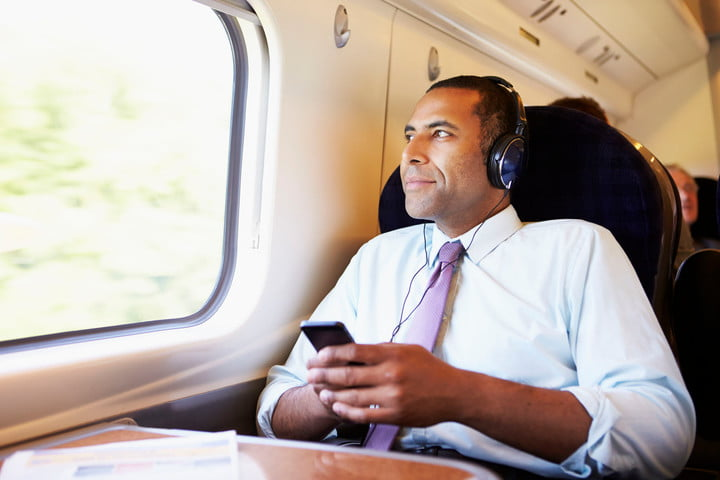 iheartmedia launches two new streaming services 28159403  businessman relaxing on train listening to music