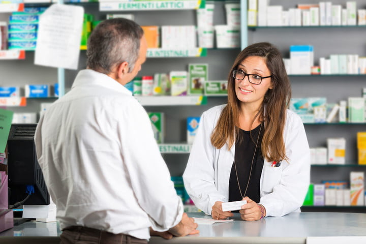 blink health free prescription med discount program 32361211  pharmacist and client in a drugstore