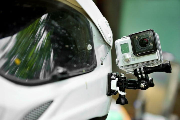 study says action camera sales will triple 33743222  with dead insects mounted on a motorcycle helmet
