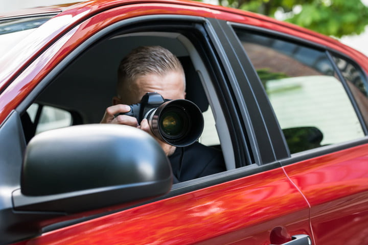 personal profiles databases records private investigators source 41144285  close up of a male driver photographing with slr c