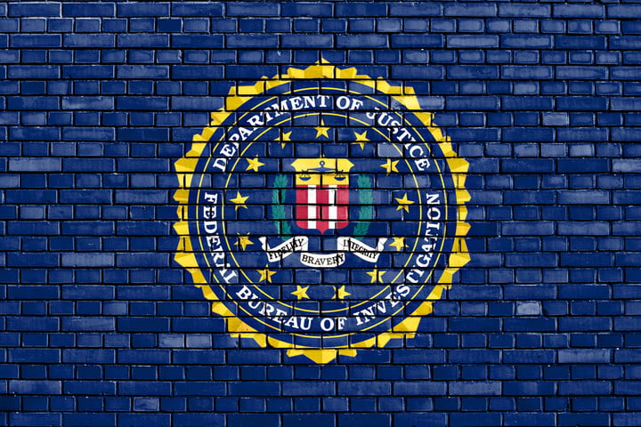 fbi warning internet connected toys 50106167  flag of painted on brick wall