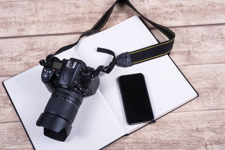 inexpensive wireless tethering for dslr 50896316  photographers workplace with book phone and camera on wooden table