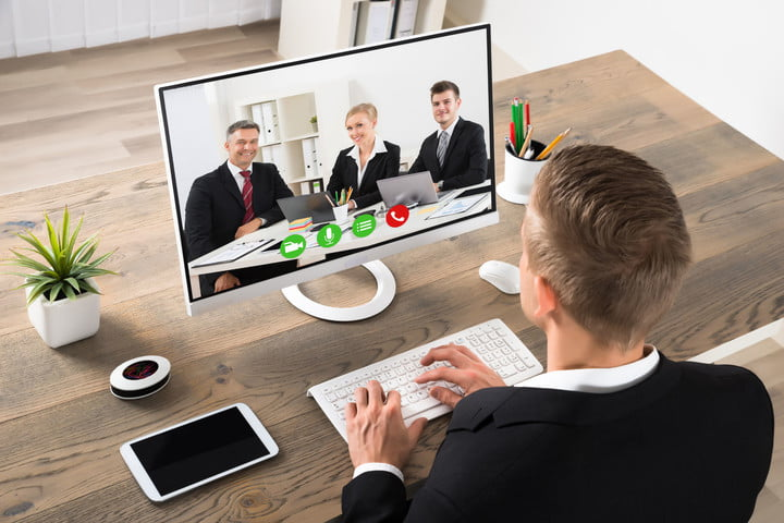 skype video calls appearance barrier 54885605  young businessman attending videoconference on computer at office