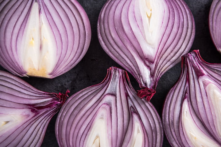 startup to network thwart snooping 56354293  red onion halves texture details and pattern flat lay from above