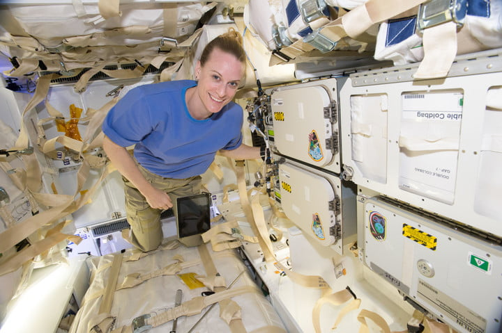 NASA astronaut Kate Rubins poses next to cold stowage Polar Facilities in the SpaceX CRS-9 cargo Dragon spacecraft in 2016. The new cargo spacecraft has more powered locker space, enabling additional cold stowage space.