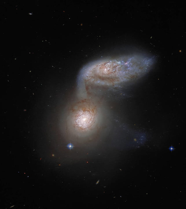 Two interacting galaxies that are so intertwined, they have a collective name – Arp 91.