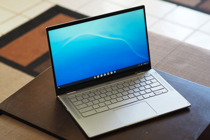 An Acer Chromebook Spin 514 sitting on a table (angled front view..