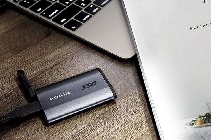 The Adata SE800 on a wood desk plugged into a laptop.