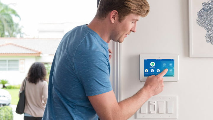 Using an ADT home monitoring screen to arm a system.