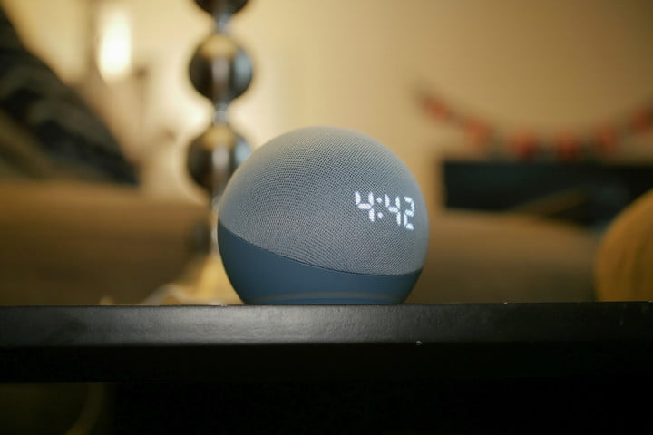 Amazon Echo Dot (4th Gen) with Clock on table.