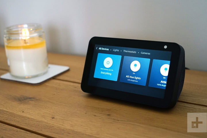 Amazon Echo Show 5 placed on top off wooden table.