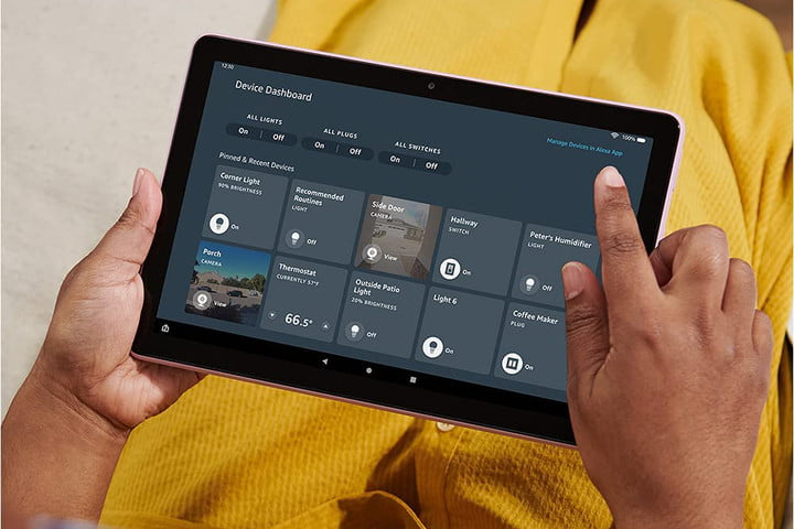 A person using the Amazon Fire HD 10 2021.