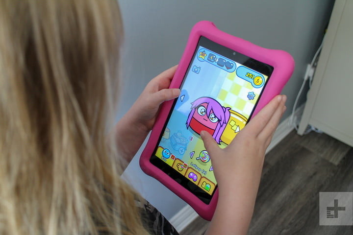 Amazon Fire HD 8 Kids Edition in a little girl's hands.