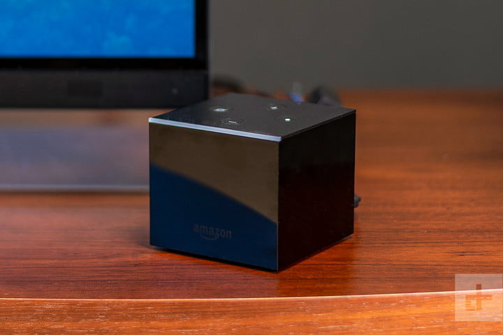 The Amazon Fire TV Cube on a wooden desk.