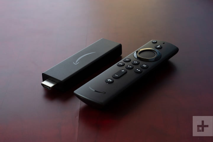 The Amazon Fire TV Streaming Stick 4K on a wooden table.