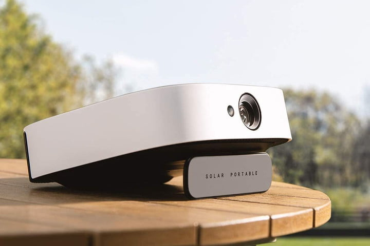 The Anker Nebula Solar projector on an outdoor table.