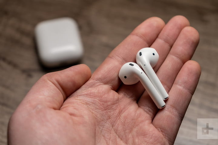 The Apple AirPods 2 in someone's hands.