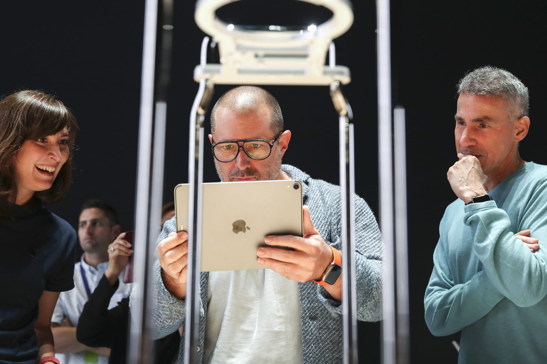 Apple chief design officer Jony Ive (middle) tests out a product at the 2019 Apple Worldwide Developer Conference.