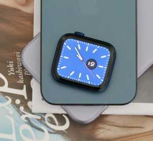 Apple Watch Series 6 body on top of the iPhone 11 and iPhone 12.