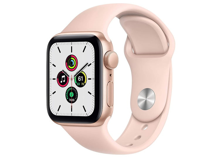 The Apple Watch SE with a gold aluminum case and a sport band in pink sand.