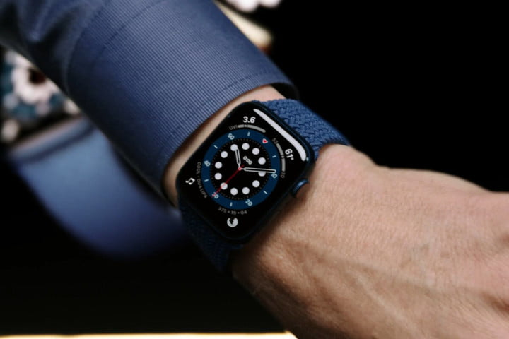 Close up of a man showing off the Apple Watch Series 6 on his wrist.