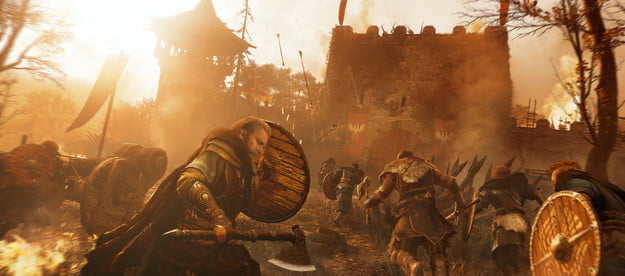 A Viking holds a shield durign a siege in Assassin's Creed Valhalla.