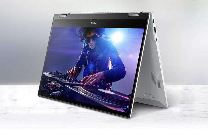 Music video playing on the Close up image on the headphone jack and USB & micro USB ports on the Asus Chromebook Flip C536.