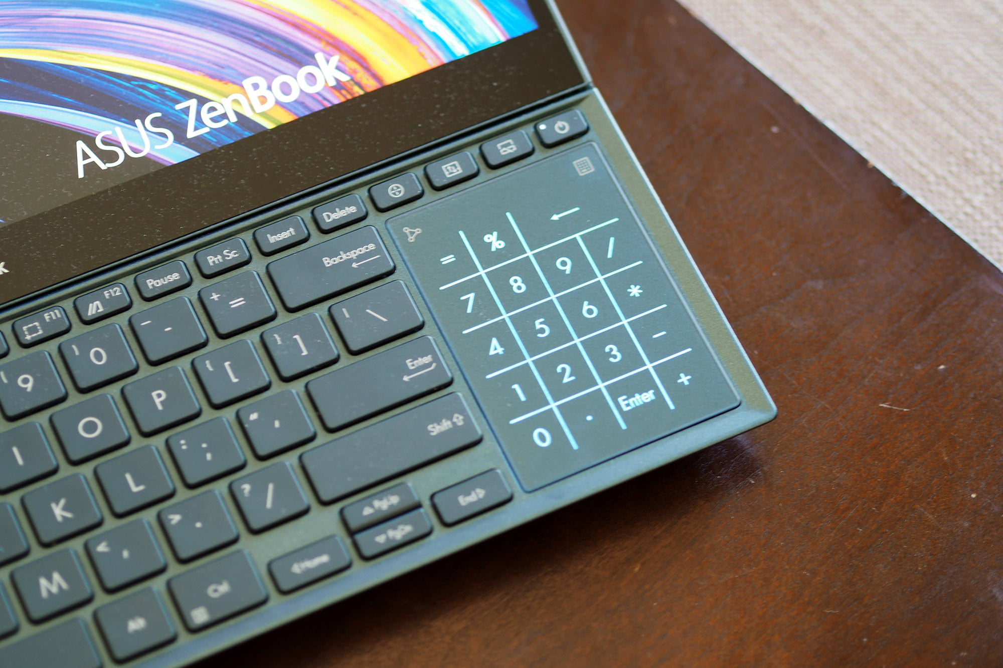 Close up on Asus ZenBook Pro Duo 15's vertical touchpad.