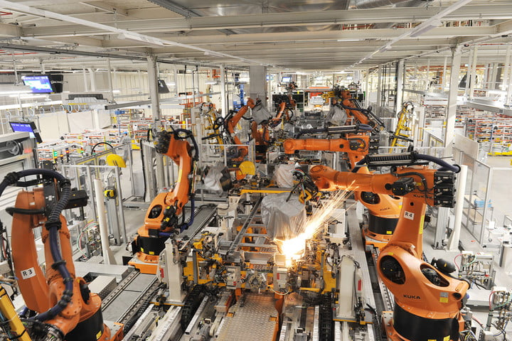 robotic arms in an automotive production line