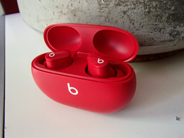 The Beats Studio Buds in their charging case.