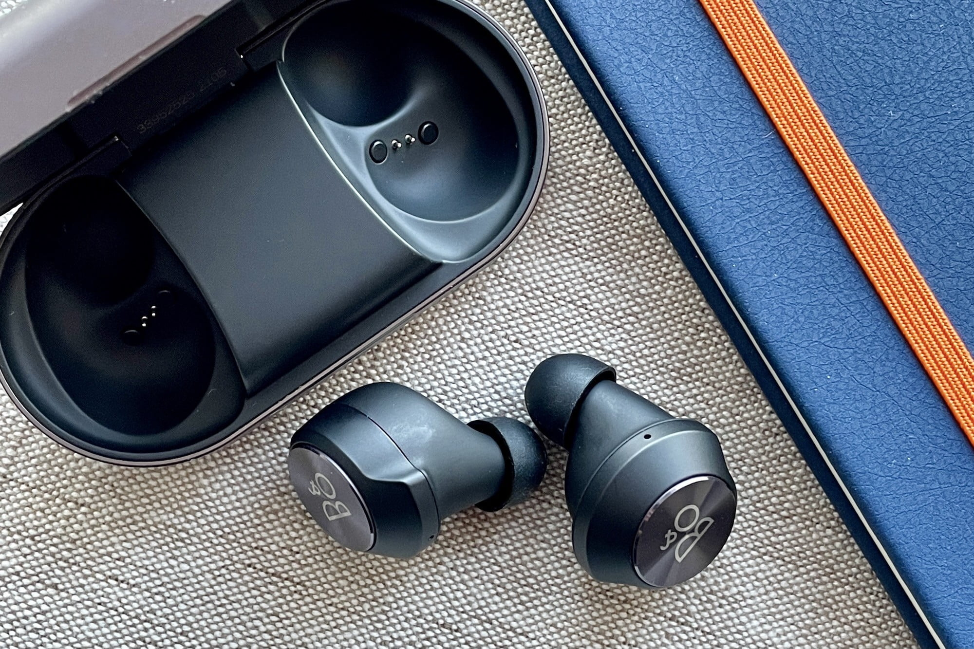 Beoplay EQ earbuds out the case, seen from the side.