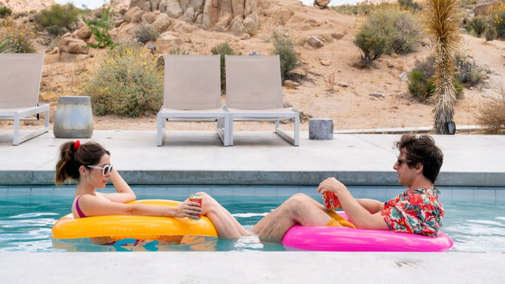 Cristin Milioti and Andy Samberg floating on inner tubes in a pool.
