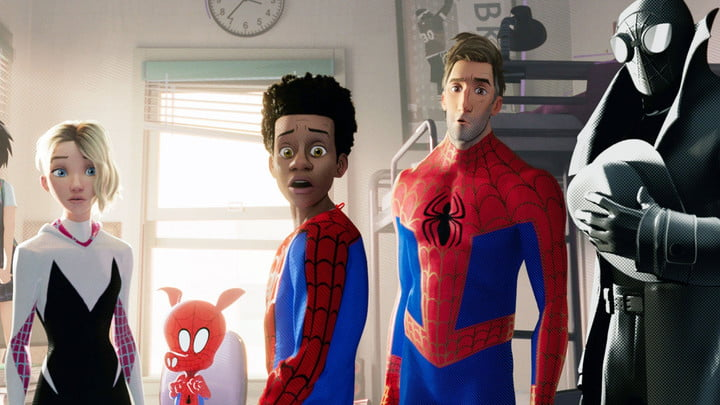 Gwen Stacy, Spider-Ham, Miles Morales, Peter Parker, and Spider-Man Noir all looking at someone off camera in Spider-Man: Into the Spider-Verse.