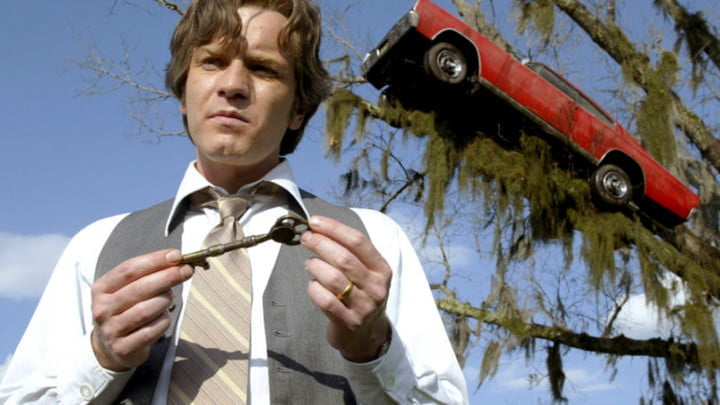 Ewan McGregor as the Young Edward Bloom. He's holding a key and staring off-camera.