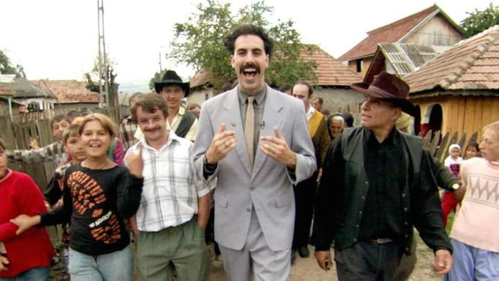 Borat surrounded by his fellow villagers.