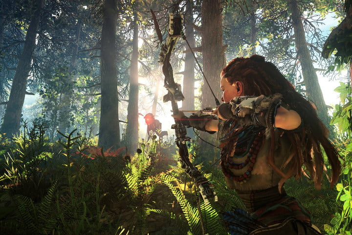 Aloy aiming her bow at a robot.