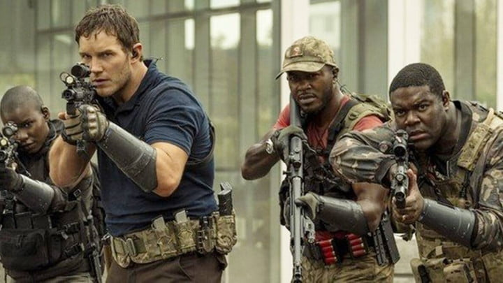 Chris Pratt and other actors in The Tomorrow War advancing with assault rifles drawn.