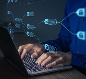 Blockchain graphic with person working on computer
