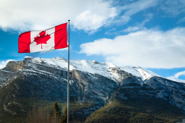 Canadian flag waving in the Rockies, from Shutterstock