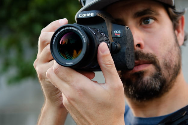 Product photo of Canon EOS Rebel T8i looking through viewfinder