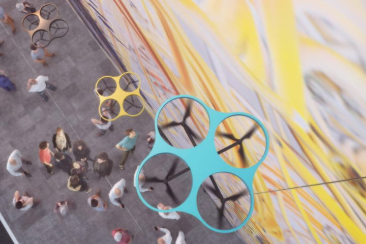 Drones at work on a Paint By Drone mural