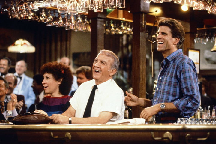 Sam and Coach behind the bar in the sitcom Cheers.